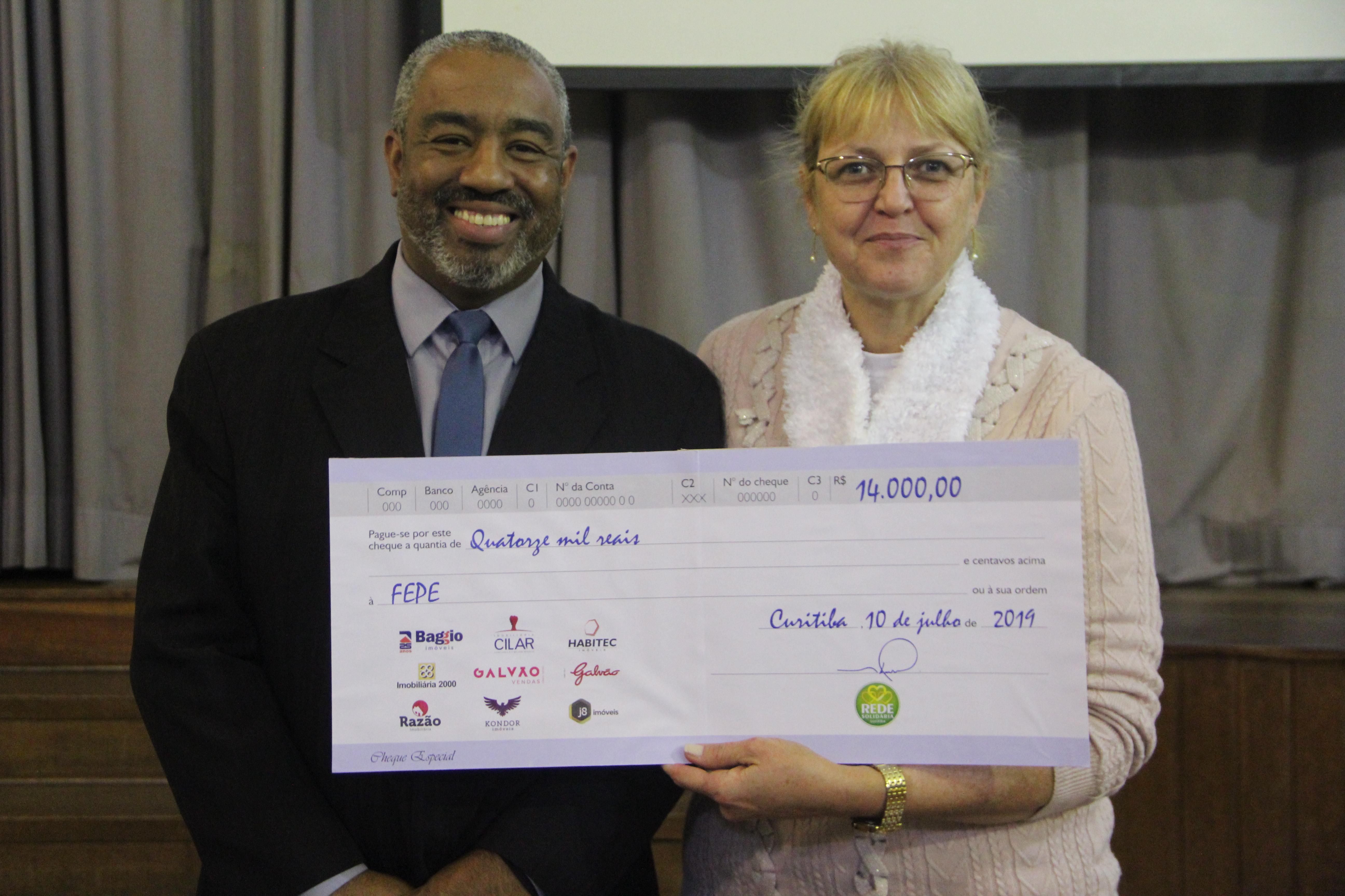 O presidente da FEPE, Alexandro Luiz Barbosa e a diretora da Escola Ecumênica, Dinéia Urbanek